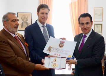 The Head of the Royal House of Albania HRH Prince Leka receiving the Order of Saint Michael